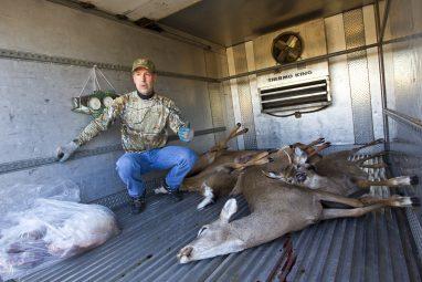 DEC officer Tom Gadomski drops off his harvested deer.