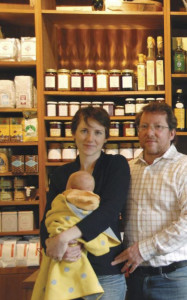All in the family. Tracey and Michael Cavaniola with newborn Spencer in their shop that has become a gustatory mecca.