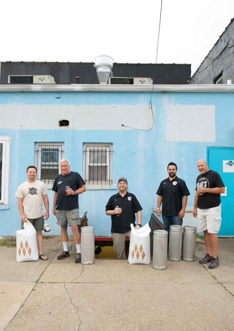 Grain heist: from left: Bobby Rodriguez of Po Boy Brewery, Jim Thompson of Taste of Long Island, Dan Russo and Tim Dougherty of Brewers Collective and Charles Becker of 1940's Brewery.