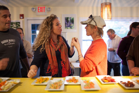 Liz Stanton (in scarf), manager at Almond restaurant, and Marilee Foster both donned orange in honor of carrots.