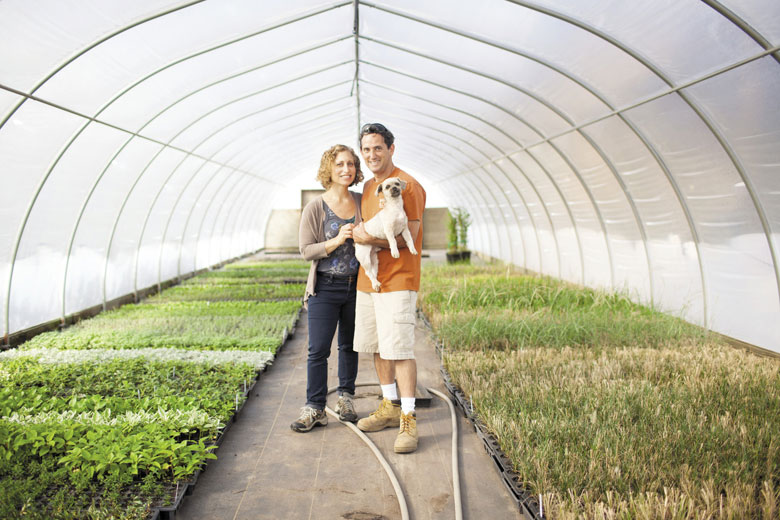 Barry Block with wife Beth-Ann in their Manorville greenhouse.