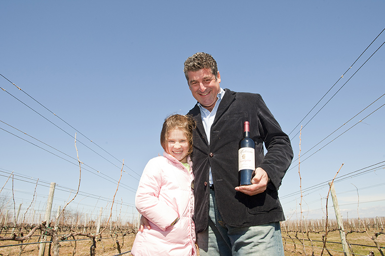 Isabella and Mark Tobin in the Mattabella Vineyard in Southold.