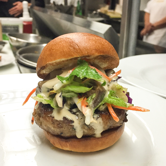 One of the four versions at Bell _ Anchor is topped with pickled mushrooms and Caesar salad.