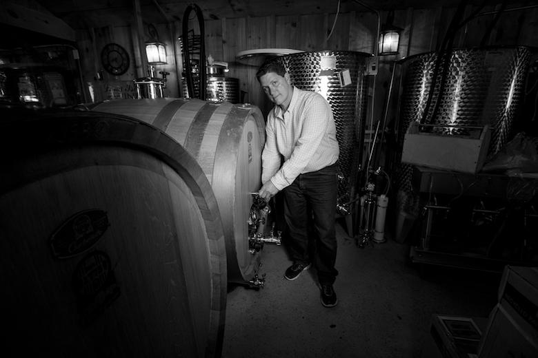 Anthony Sannino in the processing room sampling the future Spotlight. Anthony Sannino, Winemaker of Sannino Bella Vita in Peconic. 2013 SPOTLIGHT Petit Verdot.