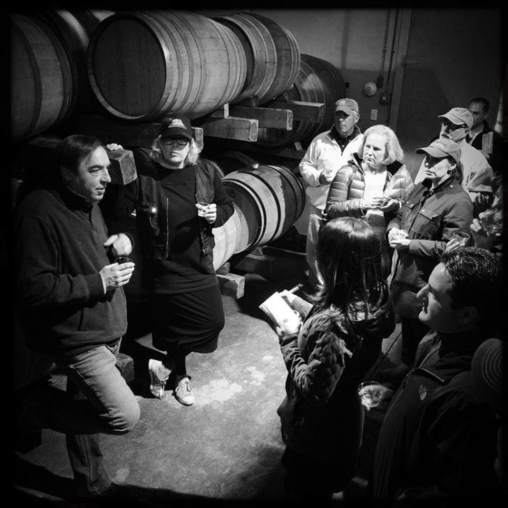 Winemaker Miguel Martin, far left, in the Palmer Vineyards barrel room.