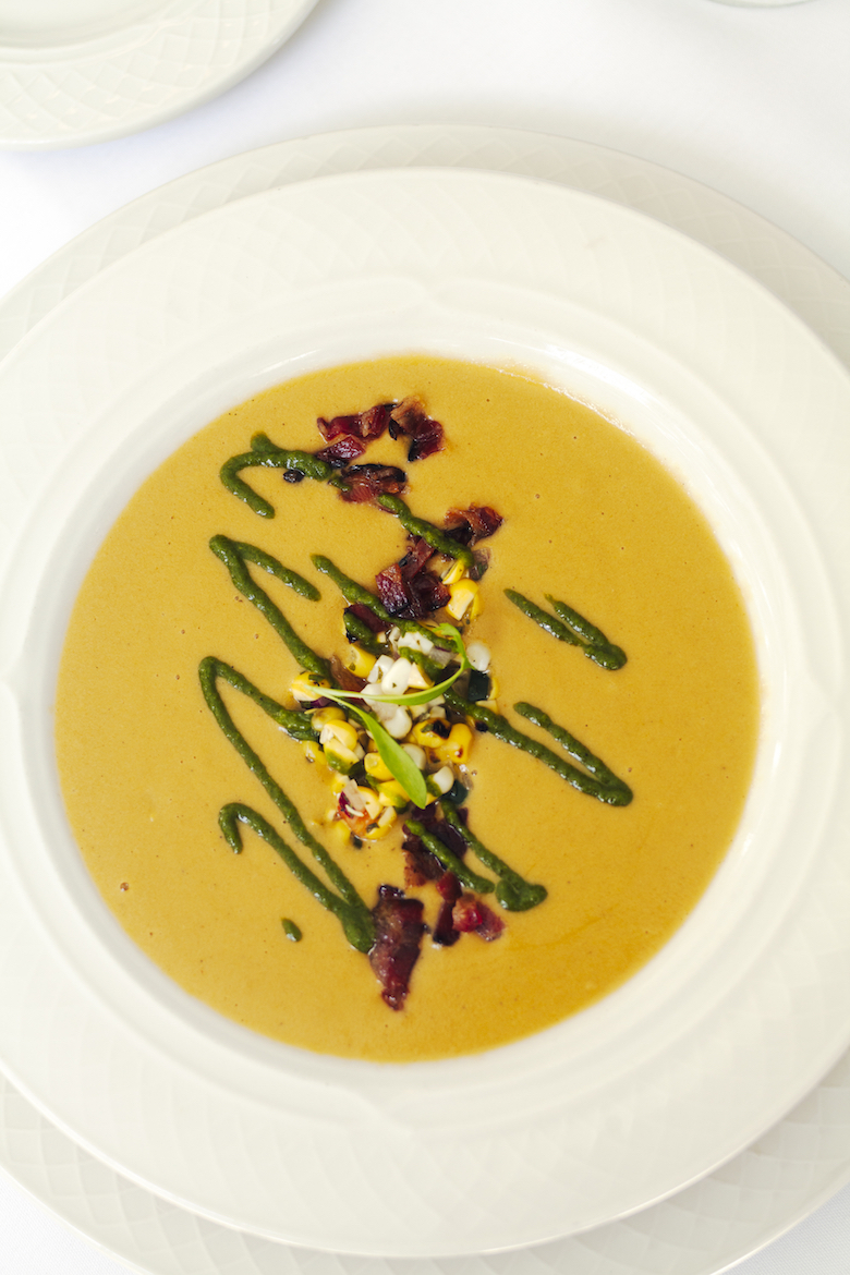 Chef Smith's Long Island Sweet Corn Bisque is essentially summer in a soup bowl—with smoked bacon, cilantro, and green chile.