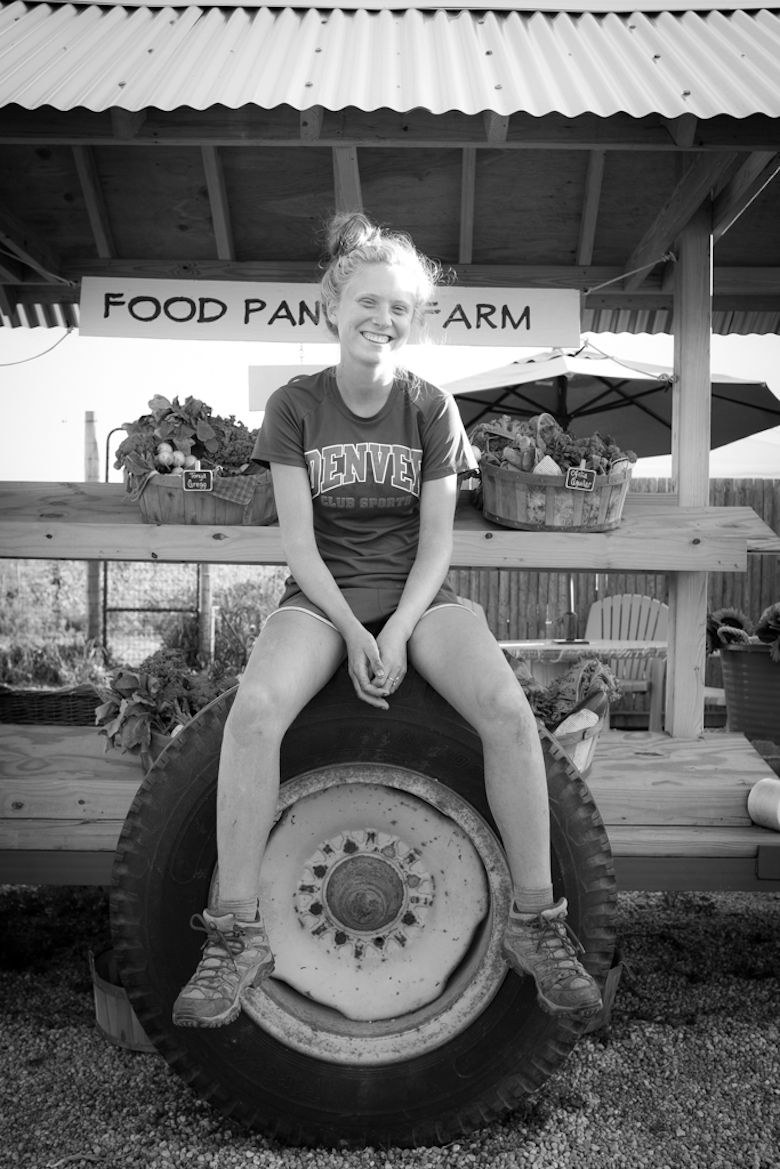 After a long day of harvesting, Katie Ketchum takes a break at the Food Pantry Farm farmstand.