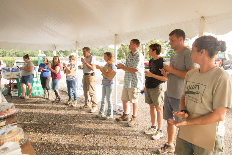 Farmers participating in the workshop on healthy soil which included lectures in the field, a barn and under a tent.