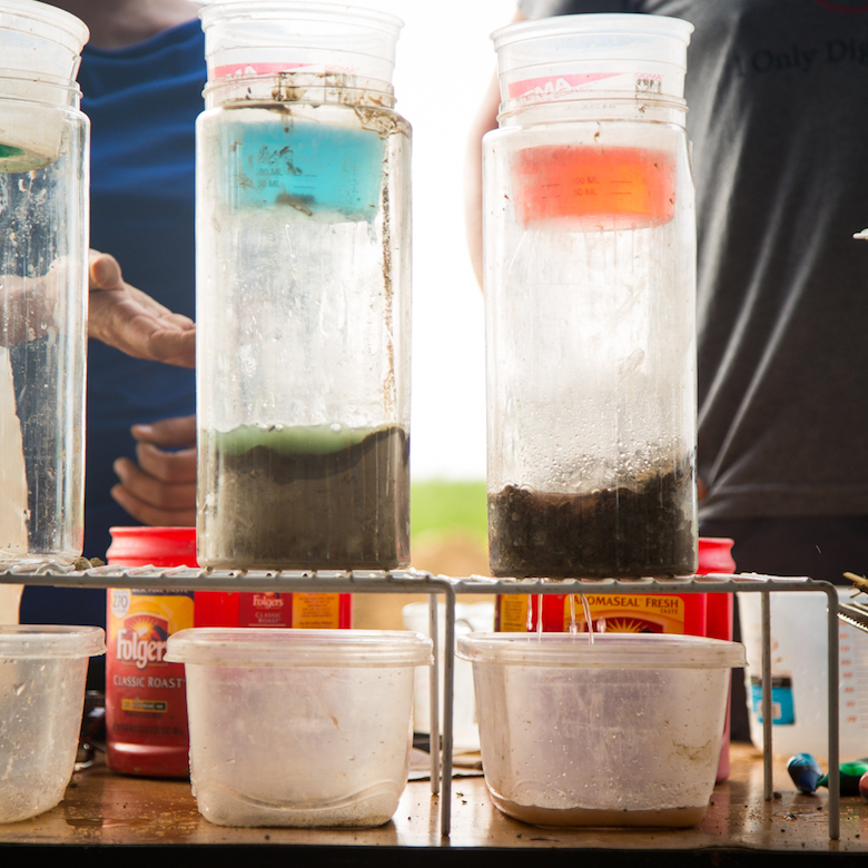 Detail of Olga Vargas of NRCS and Ken Johnson of Cornell Cooperative Extension's soil health demo.