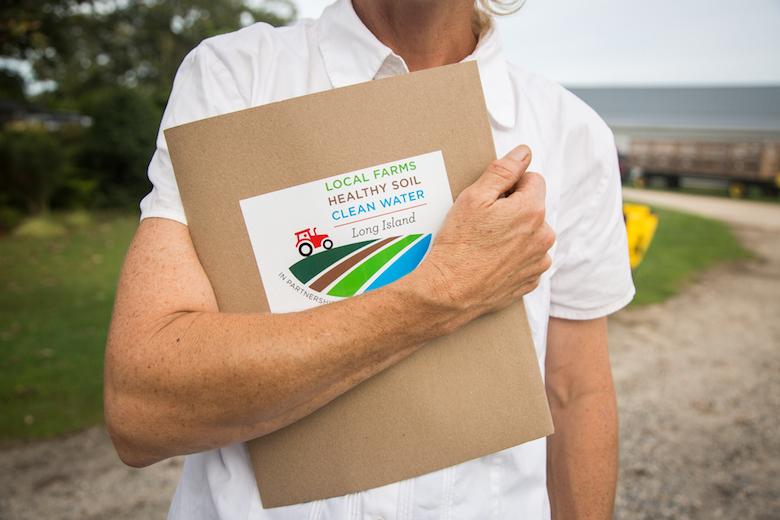 Farmer, Marilee Foster w/ her Soil Health packet.