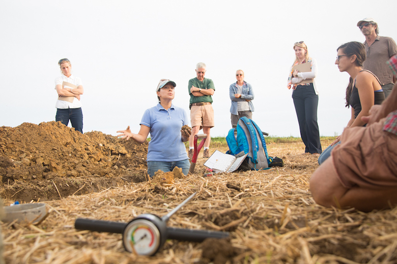 "In the ""healthy soil pit"" with soil scientist Olga Vargas of NRCS, USDA."