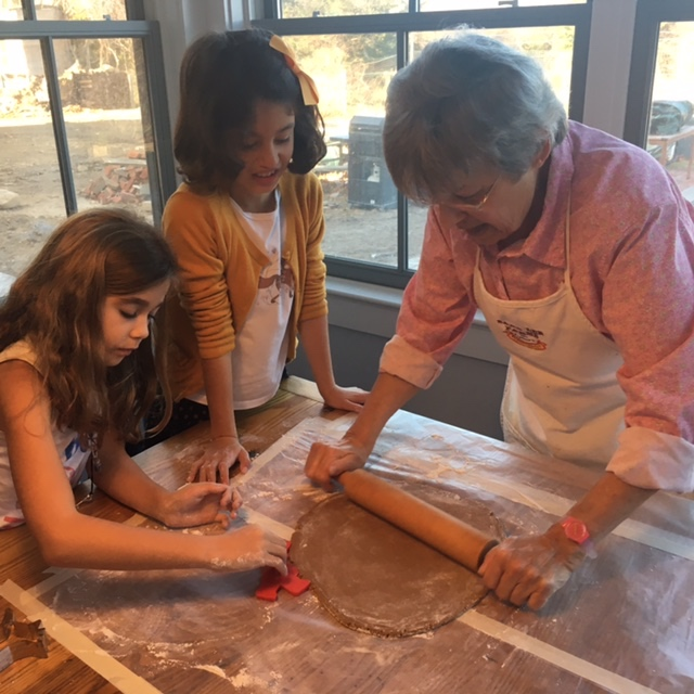 The author's mother (right) prepares the cookies with the author's daughter and one of her friends.