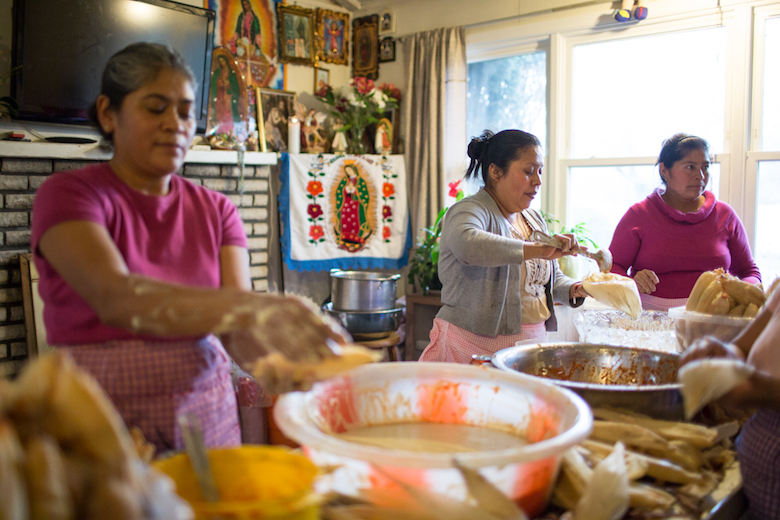 Women from Puebla, Mexico prepare tamales as an offering at the annual Virgin de Guadalupe celebration.